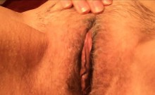 Horny granny playing with her hairy vagina