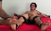 Laurent is strapped in bed in tickle torture session