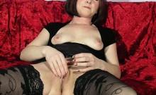 Lustful housewife in black stockings fingers her aching twa