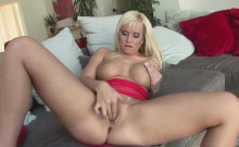 Busty blonde babe gives a masturbation show