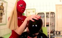 Two Babes In Latex Probing