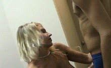 Big tits hooker rubs pussy while sucking dick