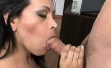 Sexy busty brunette sucking cock