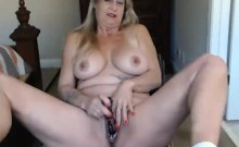 Hot mature blonde shows off her big tits and masturbates on the webcam