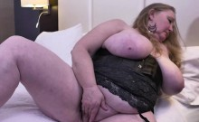 Fully shaved fat mature lady toying her pussy