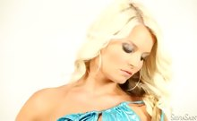 Sexy Jessie Hazel dresses in hot turquoise touches herself.