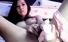 Asian cutie takes her lovely peach to climax with the help