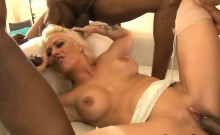 Busty blonde whore DP by big black dicks on the couch