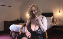 Check out this horny mature slut with her huge boobs