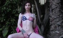 Pretty bikini tgirl stroking her cock outdoor