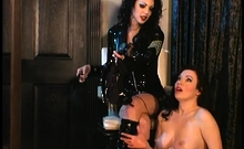 Busty brunette getting spanked by her mistress